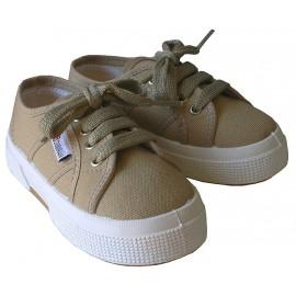 Zapatillas cordones beige.